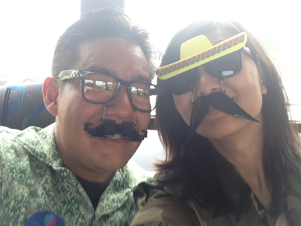 two people wearing sunglasses with moustaches