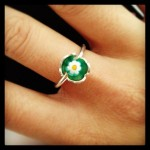 cute tous ring with bear wrapped around green and white flower murano crystal