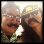 guy and girl wearing mustache glasses
