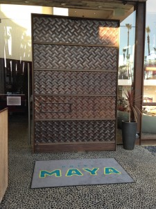 giant brown rotating door at entrance of hotel maya