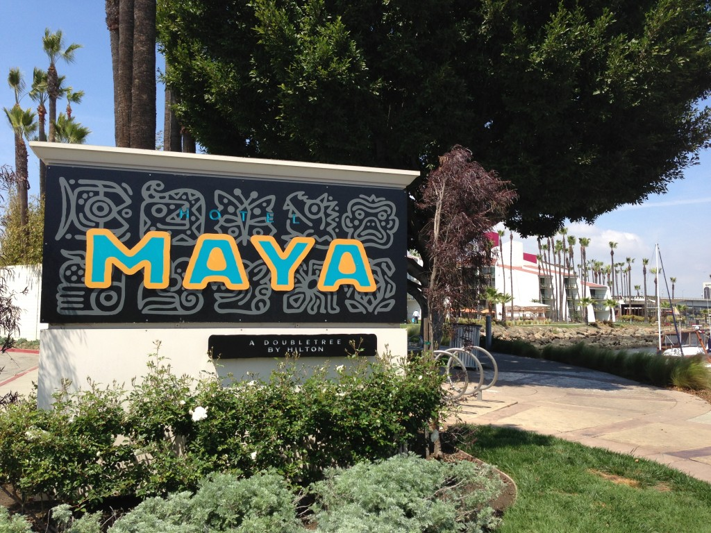 sign for the hotel maya a doubletree by hilton in long beach