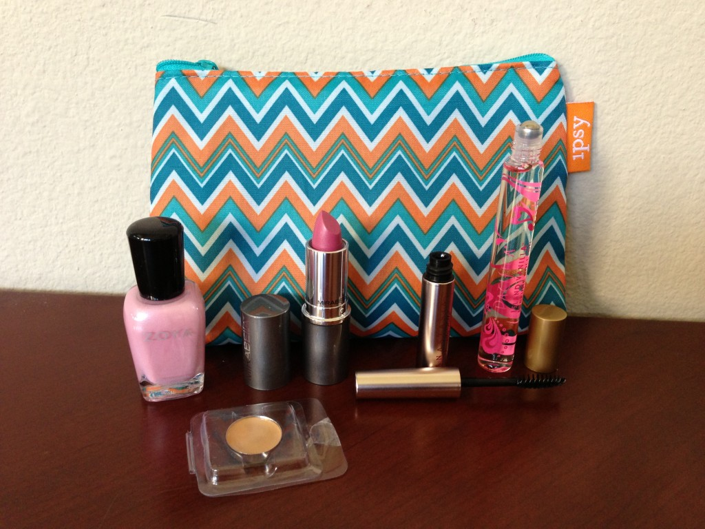 ipsy may 2013 bag items including zoya gie gie nail polish, yaby honey concealer, mirabella daydream lipstick, anastasia clear eyebrow gel, and pacifiica island vanilla perfume roller