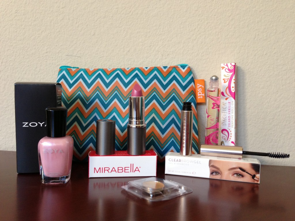 ipsy may 2013 bag items with boxes including zoya gie gie nail polish, yaby honey concealer, mirabella daydream lipstick, anastasia clear eyebrow gel, and pacifiica island vanilla perfume roller