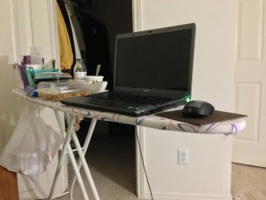 ironing board being used as desk
