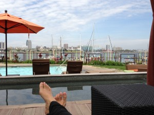 lounging by pool in cabana with view of harbor