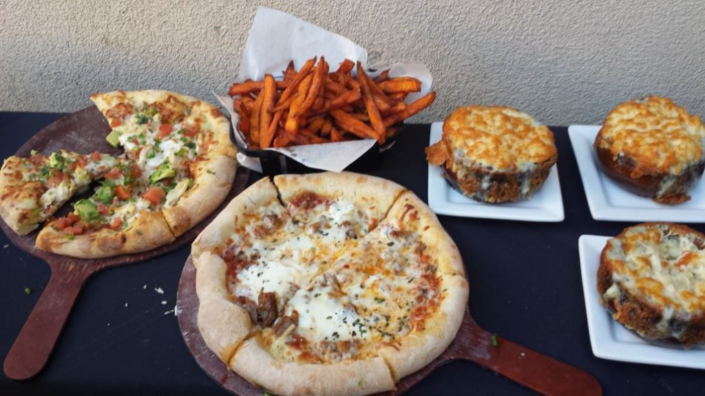 rush street food including pizza, sweet potato fries, and mac & cheese