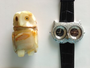 small brown stone owl sculpture and owl face watch