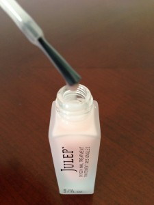 drop of julep oxygen nail treatment on brush hovering over bottle opening