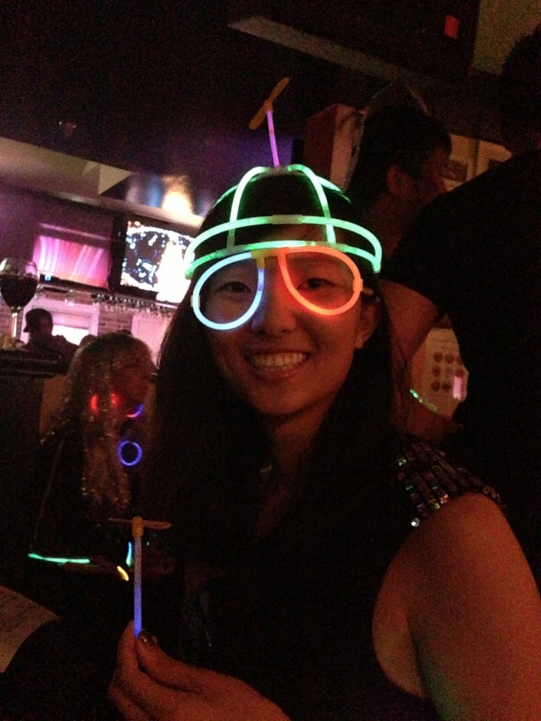 wearing glow stick glasses and propeller hat at gogobot tron themed party