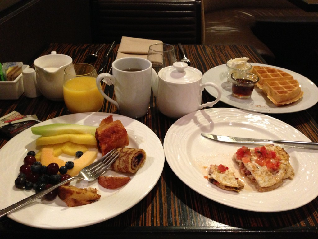 hilton anaheim hot breakfast with fruit, omelet, waffles, orange juice, tea, and more