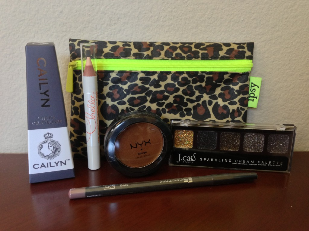ipsy june 2013 bag items including cailyn gel eyeliner in iron, chella ivory lace highlighter pencil, nyx rouge cream blush in bronze goddess, j.cat sparkling cream palette in volta, and starlooks lip pencil in bare
