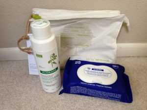 klorane bag with dry shampoo bottle and facial wipes