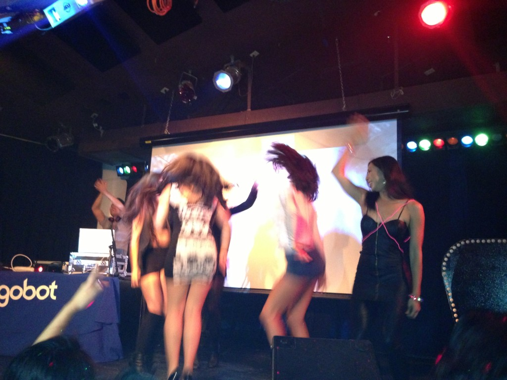 ladies dancing on stage at gogobot tron themed party busby's