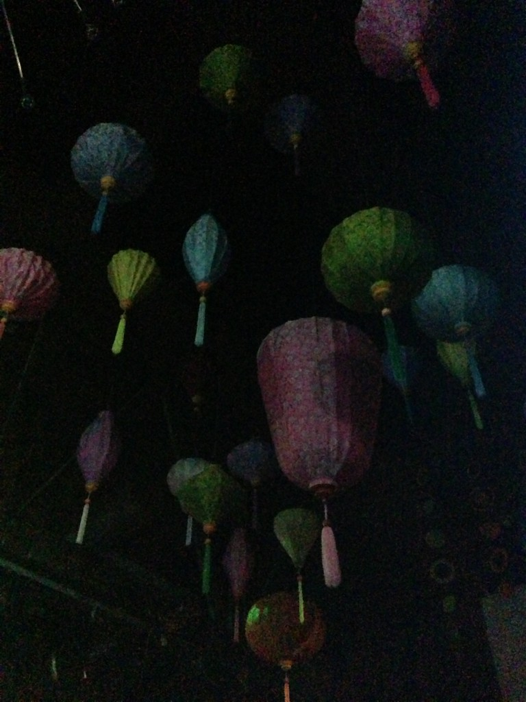 paper lanterns hanging from ceiling in dance room at busby's east