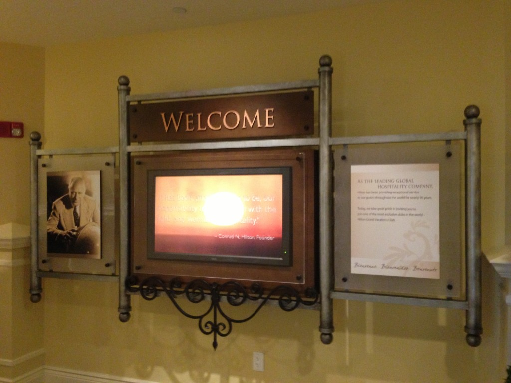 parc soleil hilton grand vacations sales center welcome sign with message from founder conrad hilton