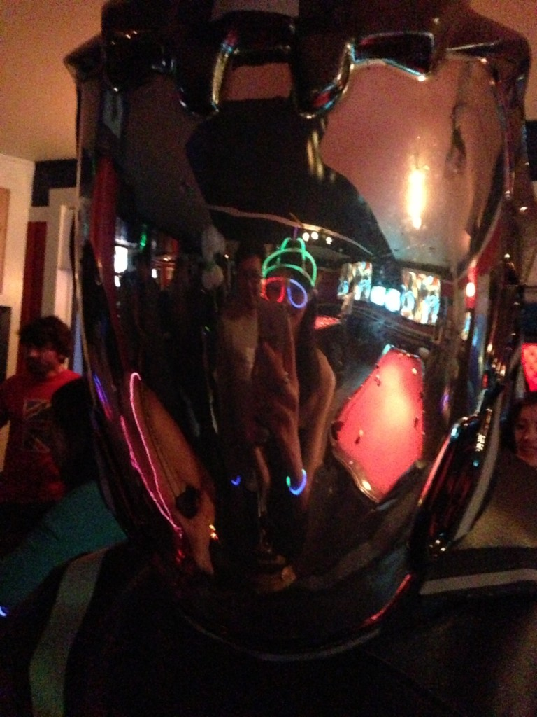 reflection in shiny tron helmet at gogobot tron themed party