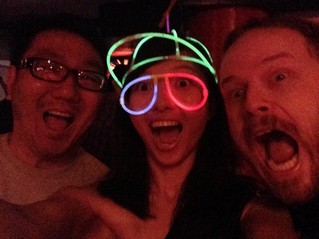 three super happy friends at gogobot tron themed party