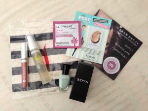 trade items including juice beauty lip gloss, juice beauty hydrating mist, zoya nail polish, la fresh oil-free face cleanser sample wipe, benefit the porefessional sample, and urban decay moondust eyeshadow sample with sephora baggie