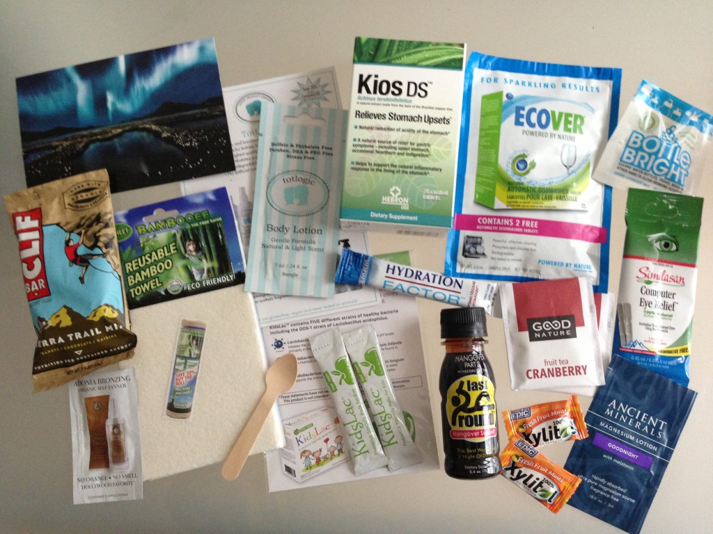 conscious box july contents including clif bar, adonia self-tanner, bambooee towel, totlogic lotion, kidslac probiotics, eco-gecko spoon, kios stomach relief, ecover dishwasher tablets, mdm hydration factor, last round hangover support, good nature tea, epic dental mints, clean ethics bottle bright cleaner, similasan eye drops, ancient minerals lotion