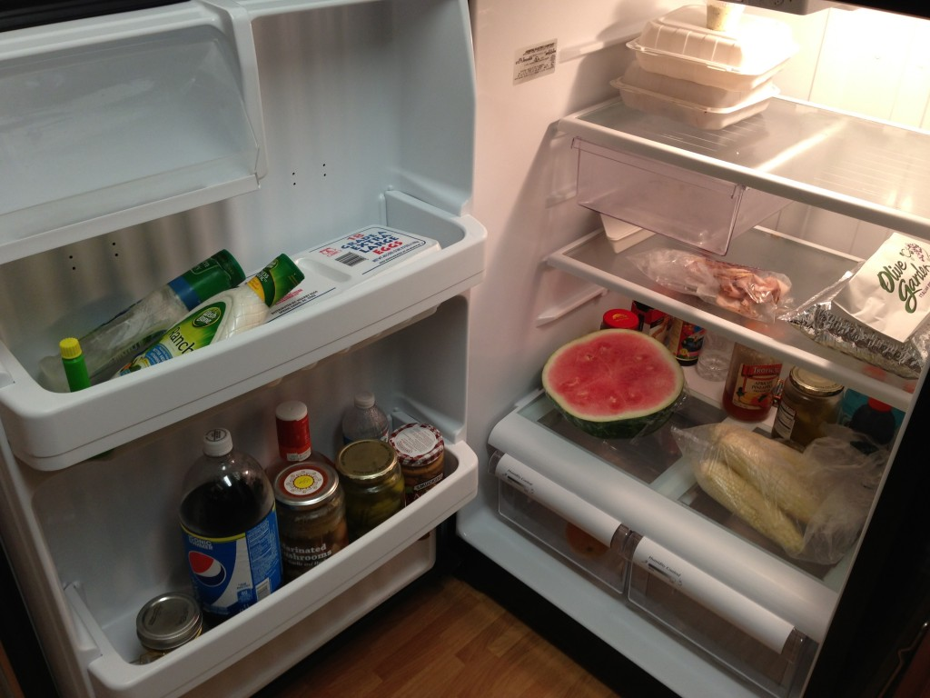 fridge door open with contents showing