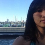 girl sitting in hot tub with marina in background