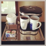 coffee/tea maker and mugs in hotel room