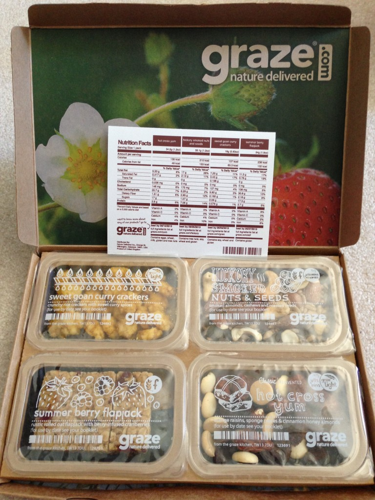 my fourth graze box with sweet goan curry crackers, hickory smoked nuts & seeds, summer berry flapjack, and hot cross yum