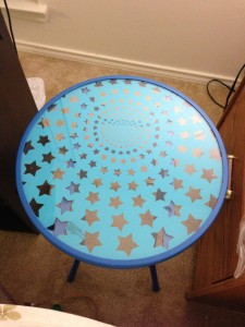 small round glass table with blue star pattern design