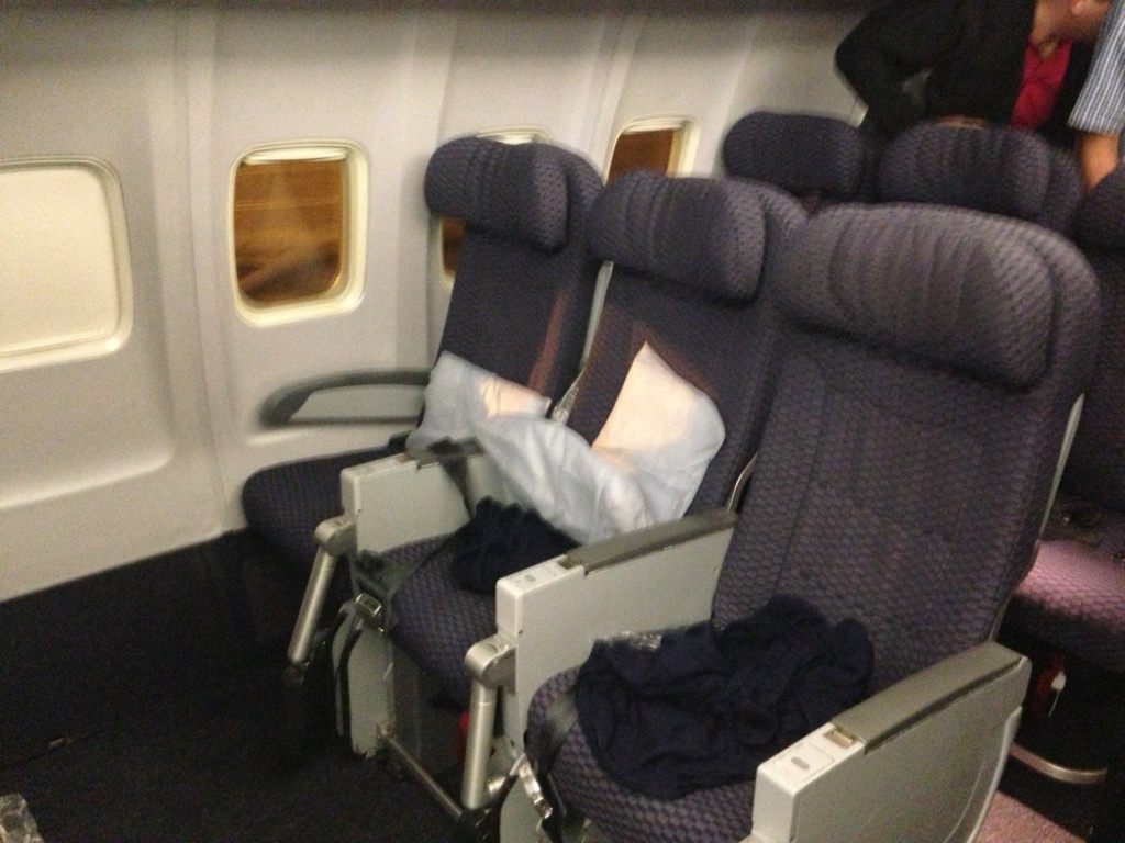 row of airplane seats in set of three