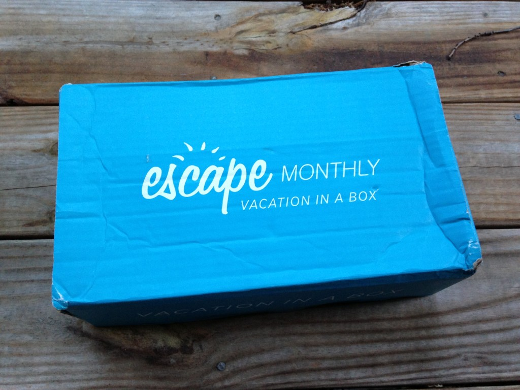 blue escape monthly box with white lettering