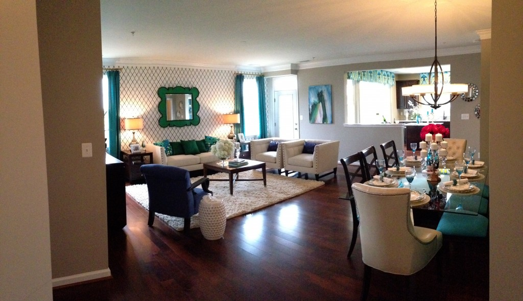 panoramic of living and dining room area of model home