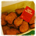 box of chicken mcnuggets from mcdonald's with tangy barbeque sauce