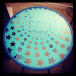 small round glass table with blue background and clear star pattern