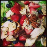 brightly colored strawberry poppy salad from panera bread