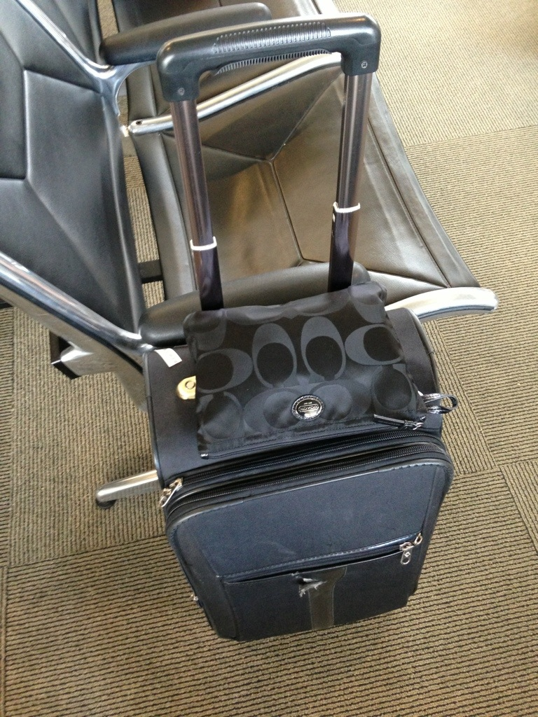 traveling light with half-empty suitcase and clutch