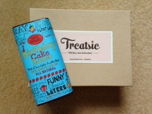 treatsie august box with seattle chocolates birthday cake batter milk chocolate truffle bar