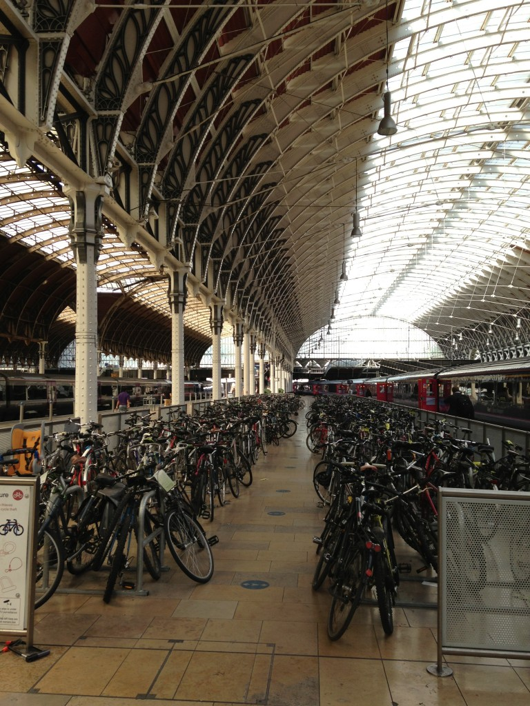 bike parking area with dozens of bikes inside victoria station in london