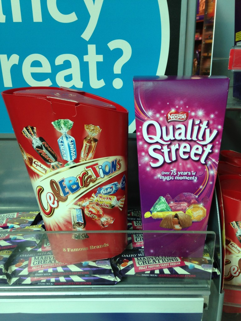 boxes of celebrations and quality street candies