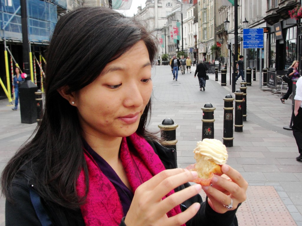 pausing to eat cupcake in middle of street in cardiff