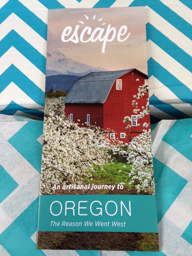 escape monthly september oregon box info card against blue and white chevron background