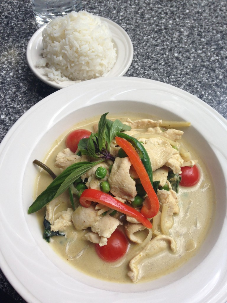 green curry chicken dish with bowl of jasmine rice at busara thai restaurant