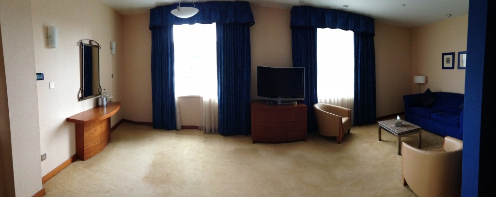 panoramic view of living room space in suite at hilton cardiff