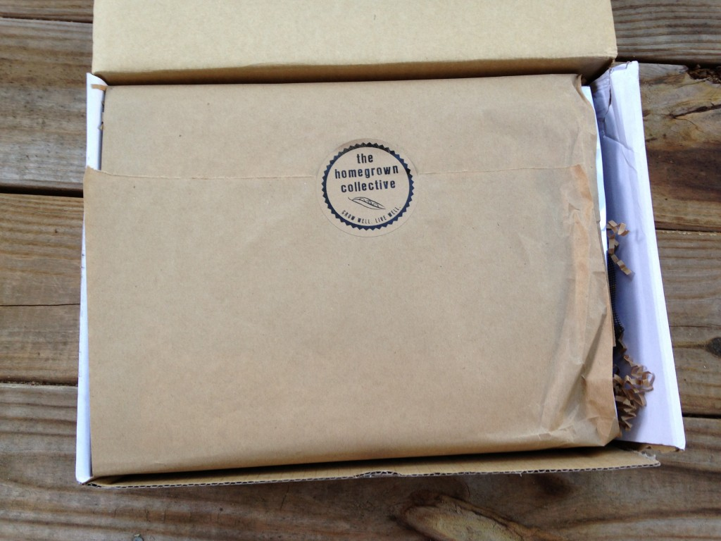 inside of homegrown collective box with the homegrown collective sticker on brown paper wrapping
