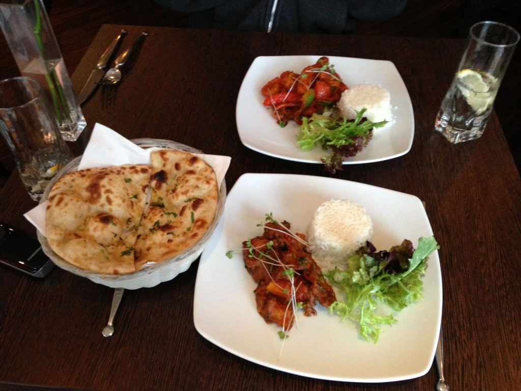 plates of indian food including naan bread