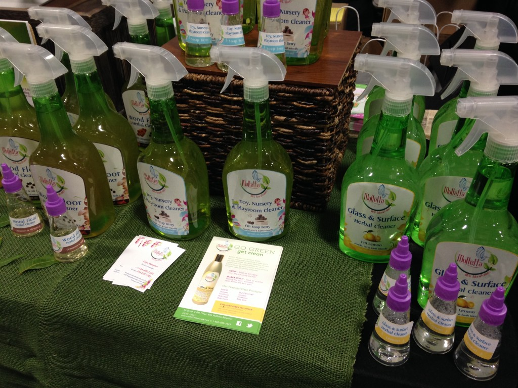 muffetta cleaning products including wood floor cleaner, nursery cleaner, and glass & surface cleaner bottles at green festival dc 2013