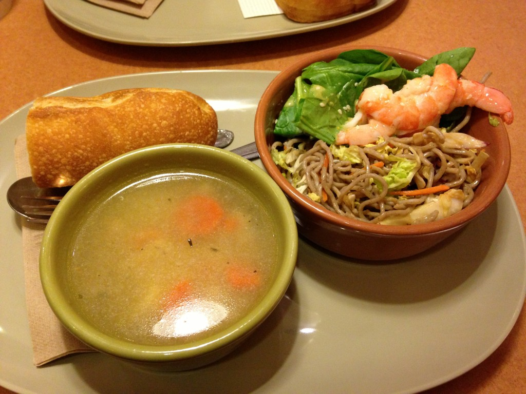 panera bread you pick two combination meal with chicken noodle soup and soba noodle salad topped with shrimp and spinach plus french bread on the side