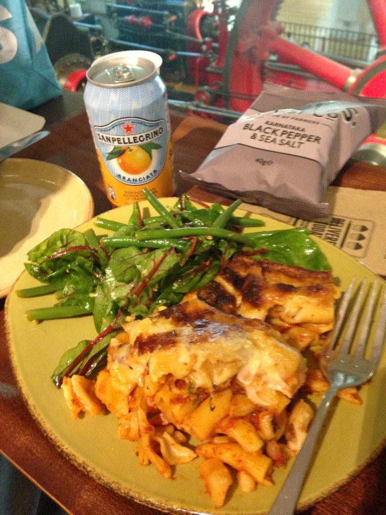 pasta bake and salad with san pellegrino orange soda drink and black pepper and sea salt chips