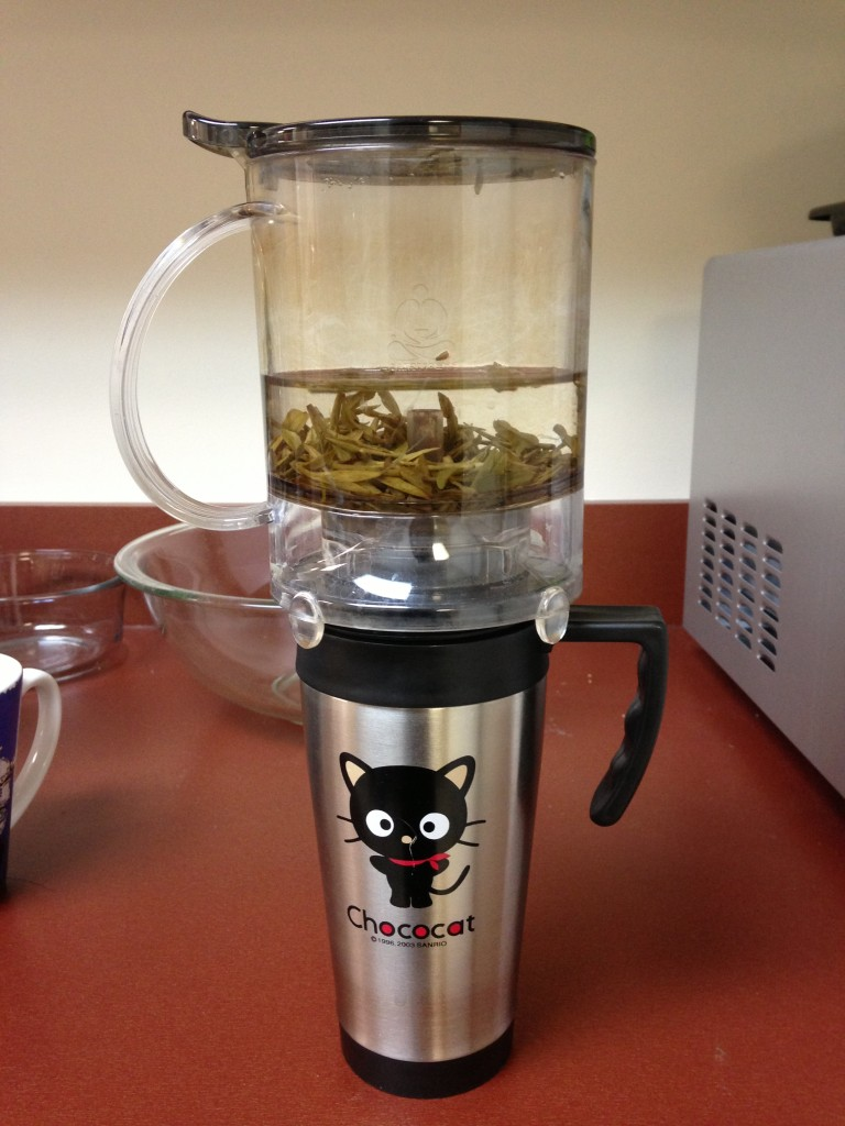 teavana perfectea perfect tea maker sitting on chococat mug