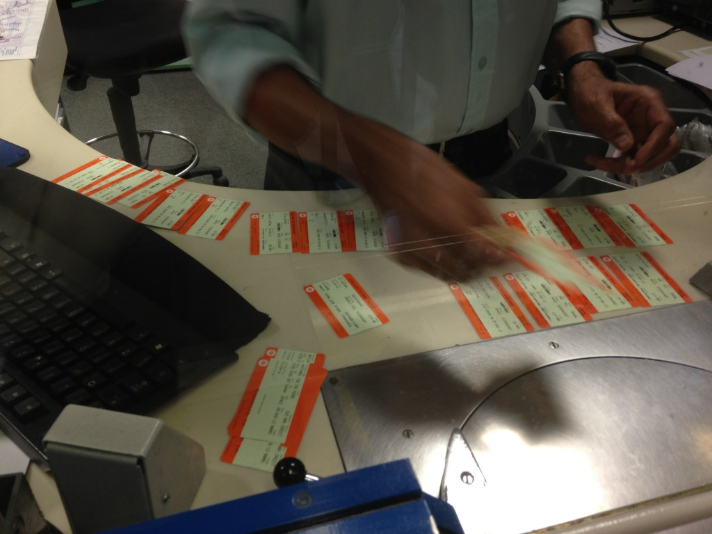 ton of train tickets laid out on table as they are printed out
