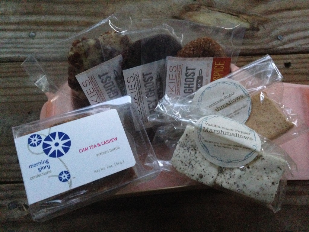 treatsie september box contents with nut brittle, cookies, and marshmallow squares